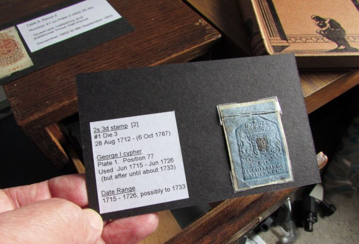 Filing system for embossed revenue stamps