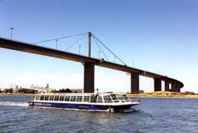 A ferry on the Yarra River under the West Gate Bridge