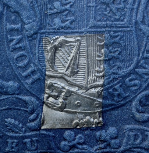 10 shilling embossed revenue stamp escutcheon